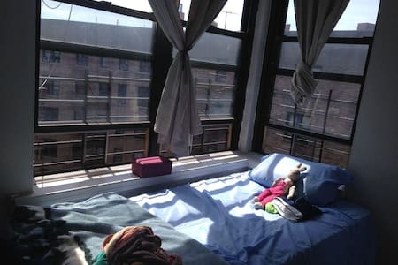 Private Bedroom in family home, located in Inwood, Manhattan from June 26th through September 9th.  For only $700/month, (we can also figure out a cost for day or week) our tenant would also have use of the rest of our apartment, including free Wifi.
