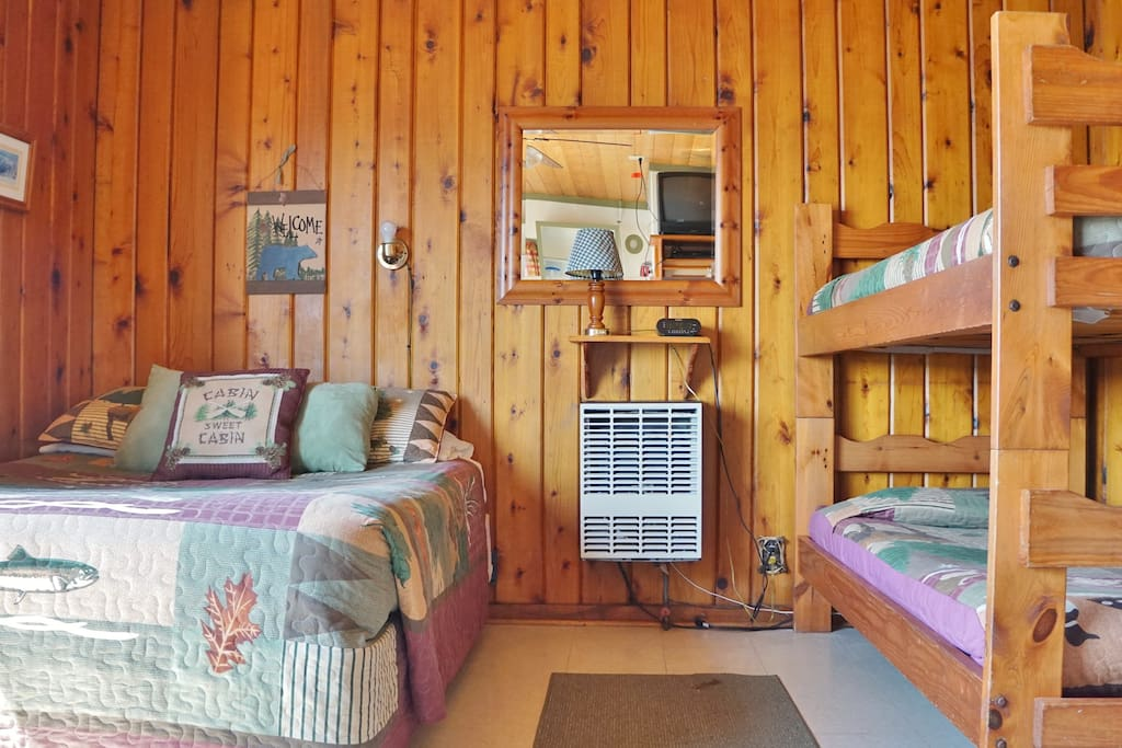 Cabin 1 sleeps up to 4 people in queen bed and set of bunk beds