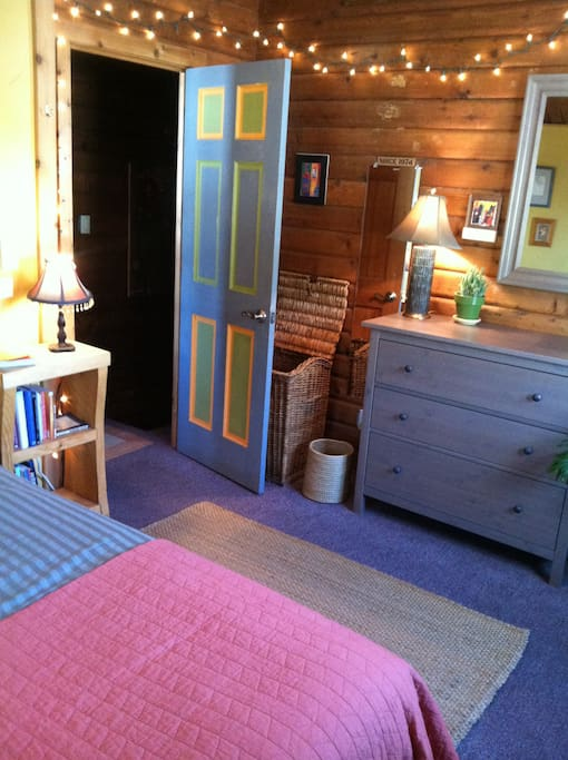 the guest room is spacious, with cool lighting and a rustic charm