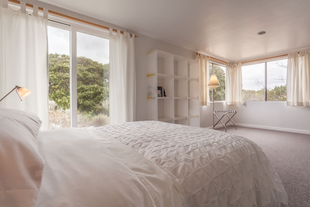 Separate bedroom with nice views of the ancient stand of coast live oak trees.