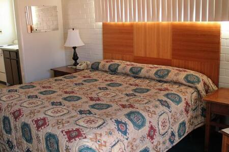 Offering a queen size bed. The room consists of micro/fridge. We have full cable & HBO. Don't forget the FREE WiFi! We also have a pool available. We have ample parking as well next to your room. We are western themed apartment style rooms.