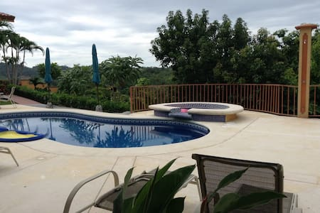 Alta Vista, has mountain Breezes with Pacific Ocean Views of Jaco Beach. Breath taking. Located up high on a Hill side enjoy Alta Vista Unit #3 for the privacy and location. Three bedrooms 2 baths, garage with  American Style Kitchen, Pool,BBQ area.