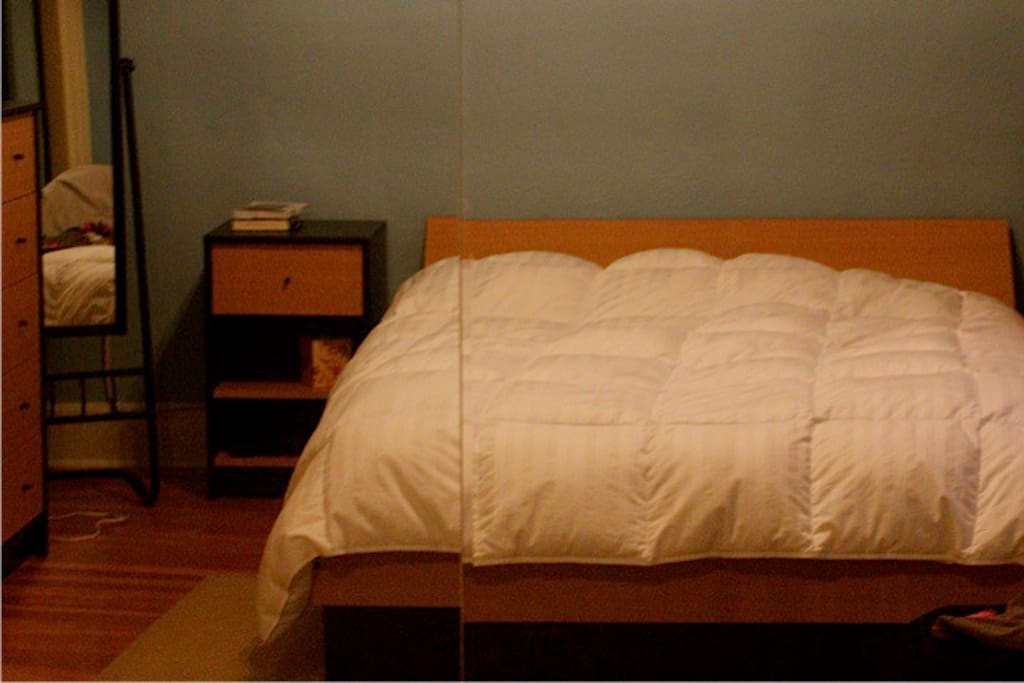 queen bed with contemporary wardrobe and bed tables