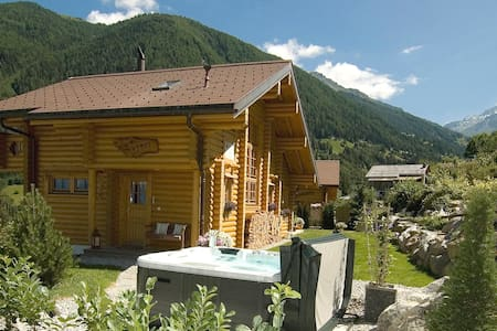 Enjoy the amazing views from our comfortable luxury chalet apartment whether you are on the terrace, in the Jacuzzi or simple looking out the window. Situated in a peaceful area, yet only a few minutes drive from local shops.