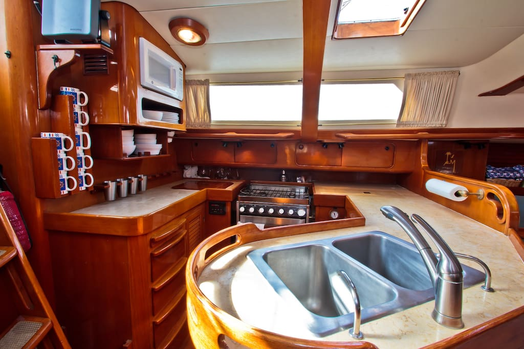 The perfect mixture of modern convenience with traditional yacht style. Marble counter tops, 4 burner range, oven w/ broiler, microwave, sink and everything you need to make a delicious meal.