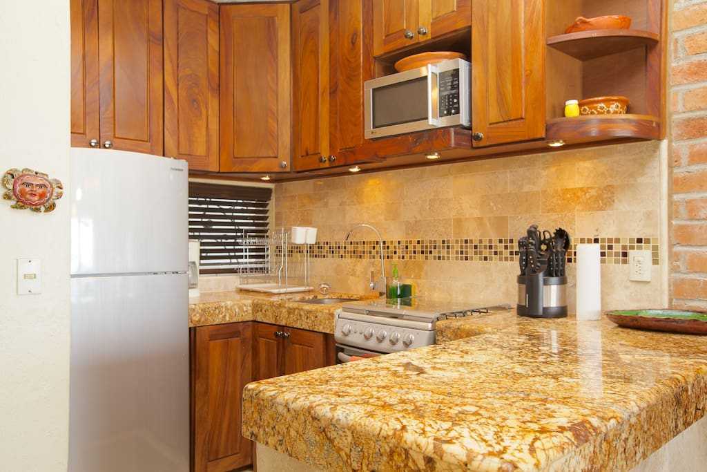 Cook's kitchen with all equipment and utensils for snacks or gourmet meals.