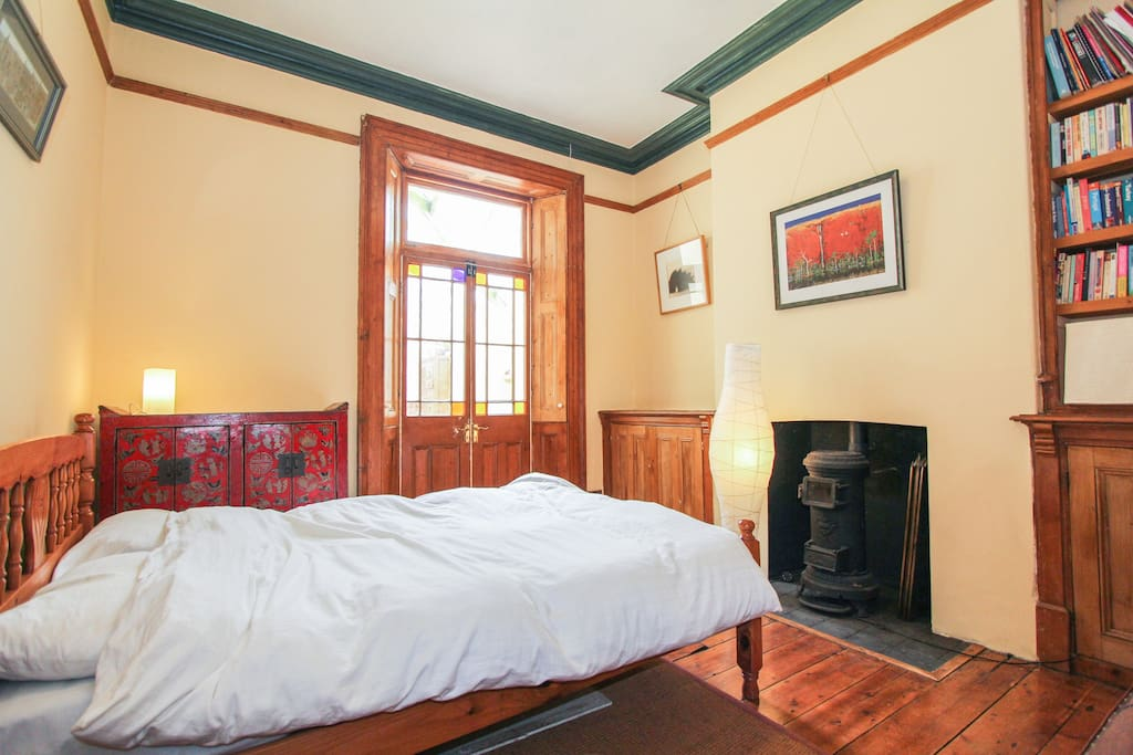Bedroom with wood burning stove. Private bathroom