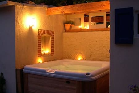 Village house with hot tub :-)