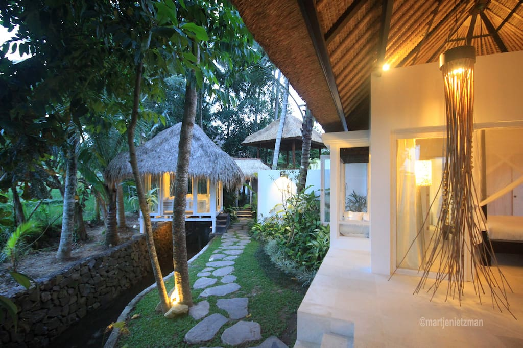 Poolside bedroom with lounge chairs looking across the rice fields