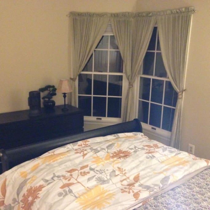 Windows with satin curtains.