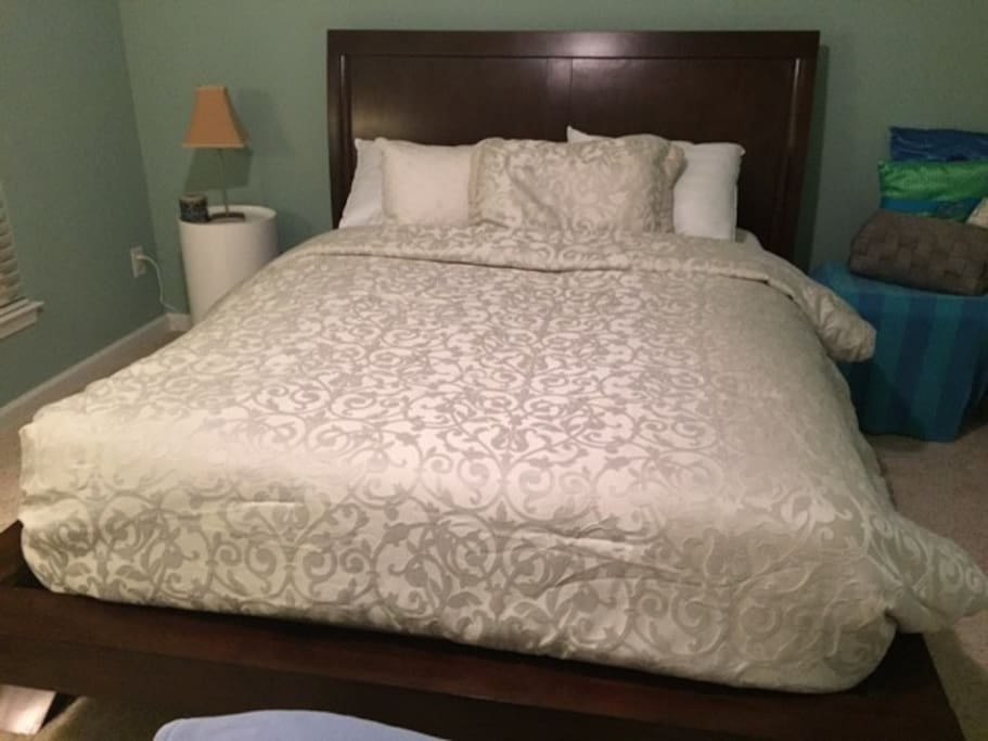 Queen bed with pillows galore and freshly laundered sheets