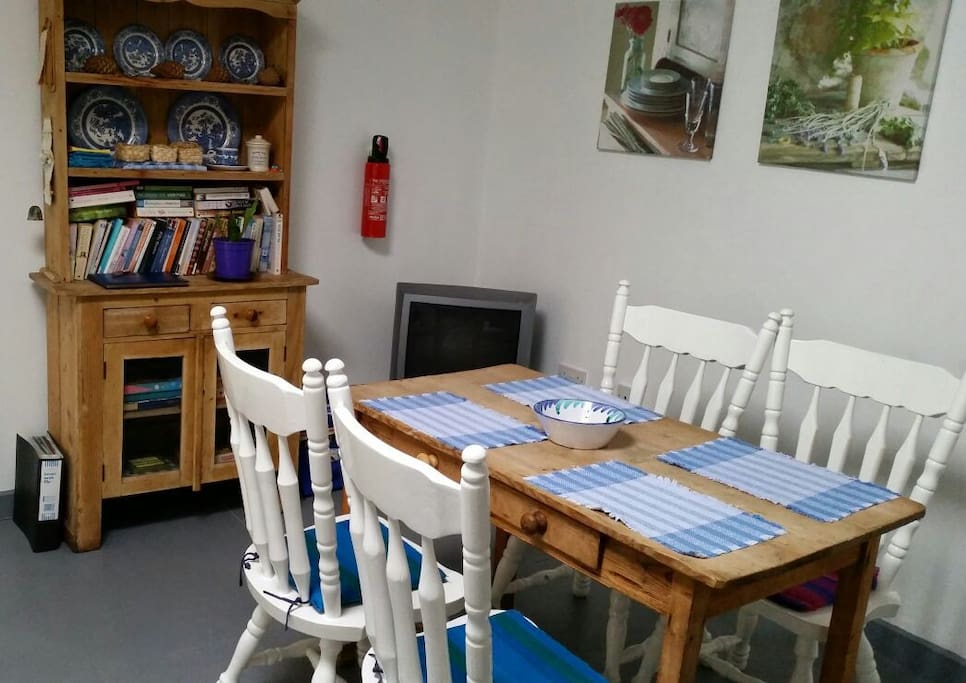 Dining area with old pine dresser and table.