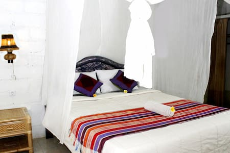 Fitted with a private terrace overlooking the garden, each room is fitted with either a fan or air conditioning. The private bathrooms come with hot shower facilities. Mosquito nets are included.