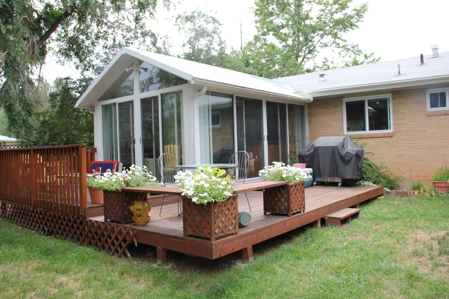 Our sunroom and deck with plenty of outside seating and a gas grill