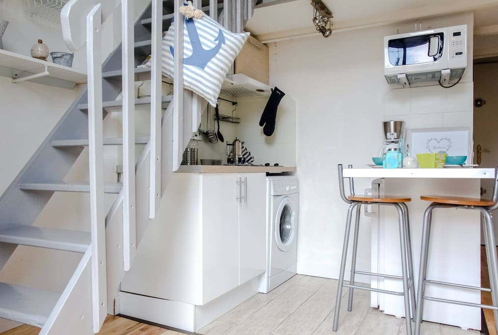 Kitchen and staircase to the loft