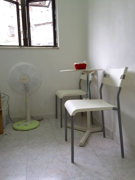 Electric fan, chairs and laptop table