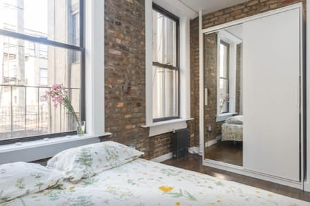 Spacious bright room with queen size bed and private bathroom in a room next door. The most exciting area in NYC, Lower East Side close to Soho and Nolita. Next to the best restaurants and bars. Few steps away from metro station.