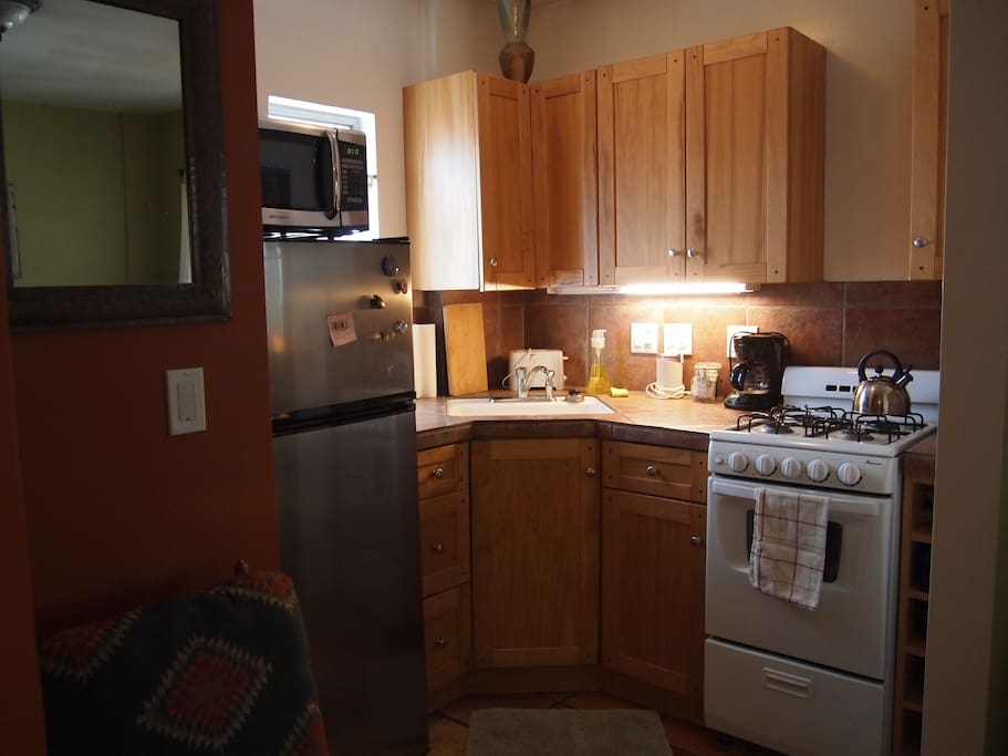 Kitchen area with 4 burner stove and oven, microwave,toaster, coffee maker and french press