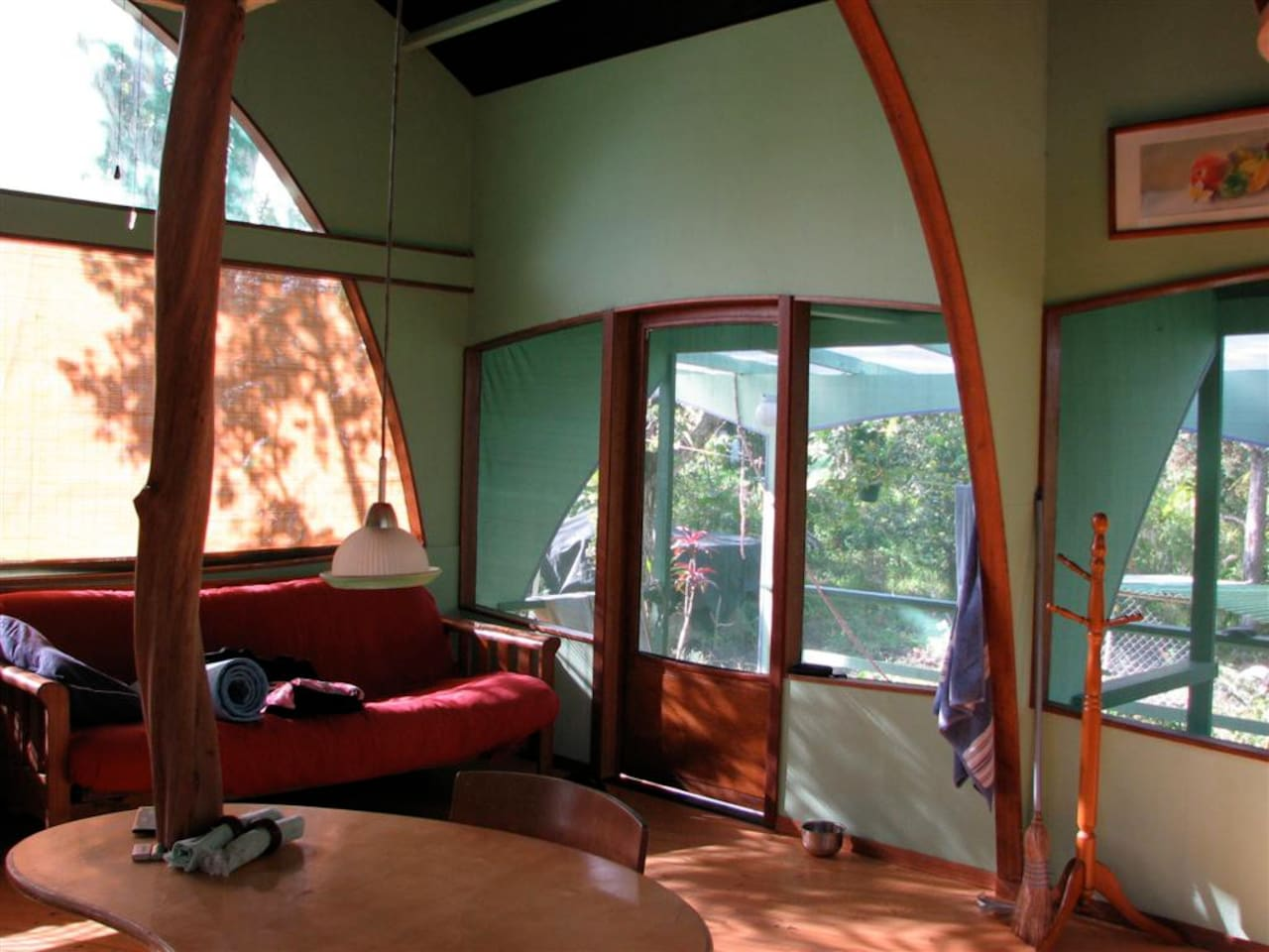 Curving lines, high ceiling, ohi'a post and mahogany trim create a simple elegance.