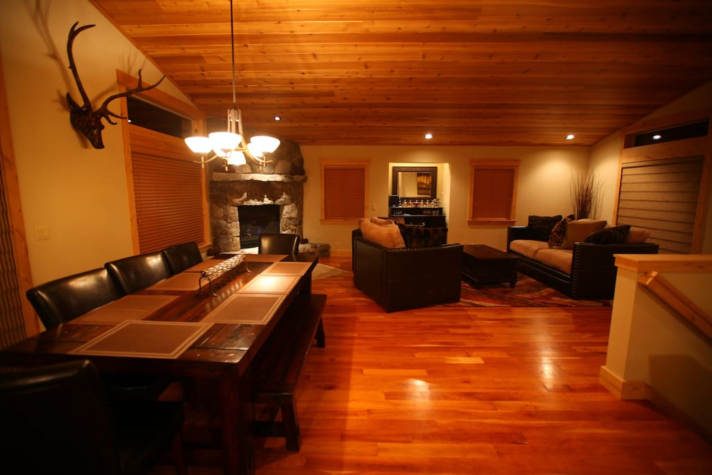 The living room and dining room flow together with a warm hearth at the corner