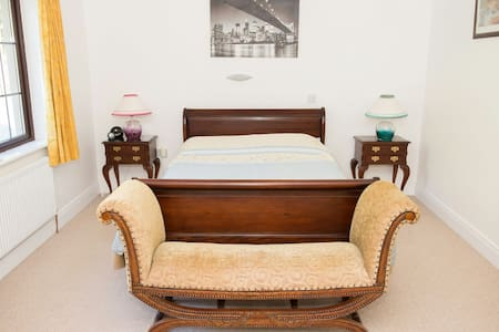 Kingsize  Bed boasting antique furniture, bright, spacious with its own ensuite