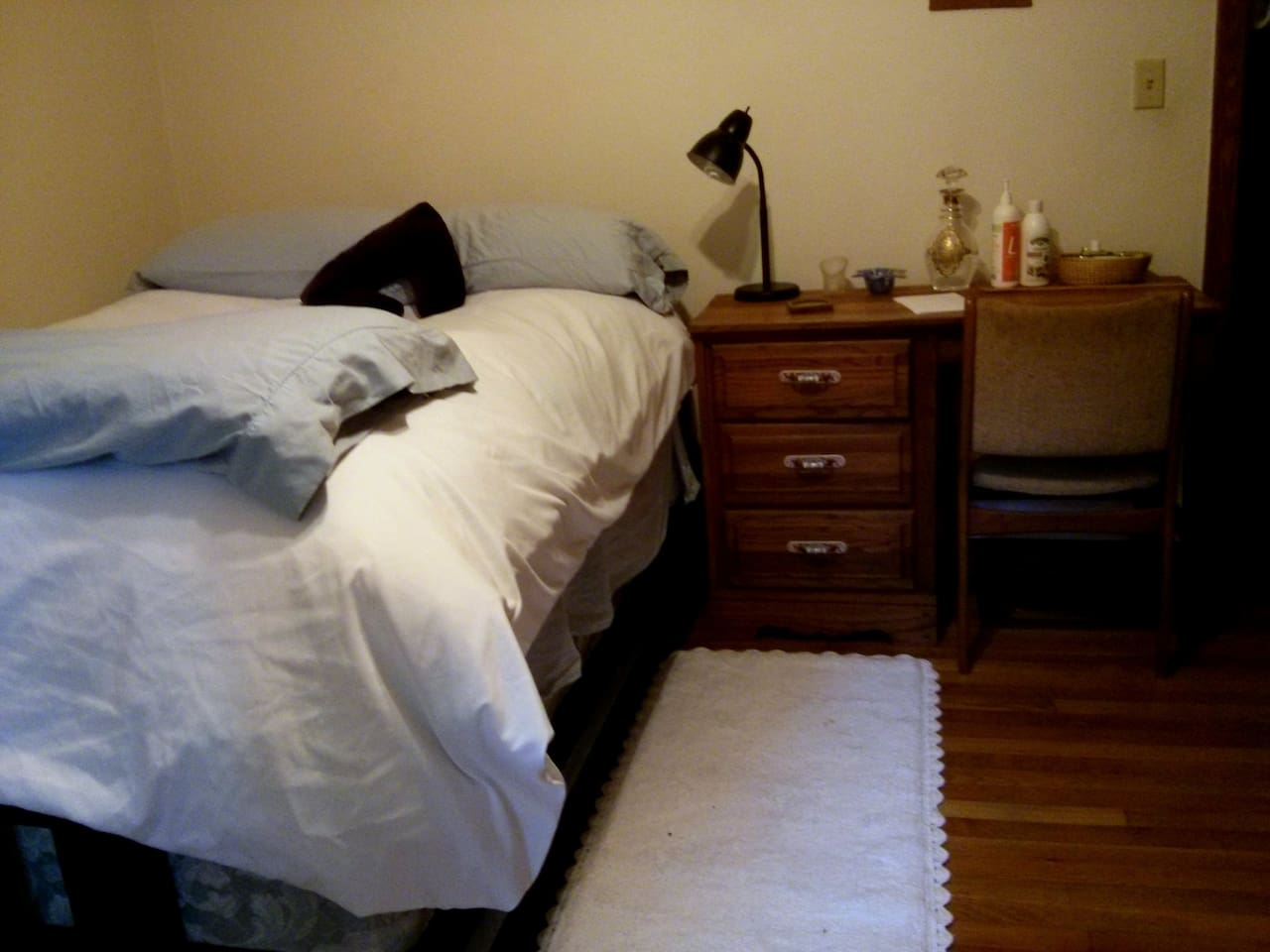 Feather bed, desk.