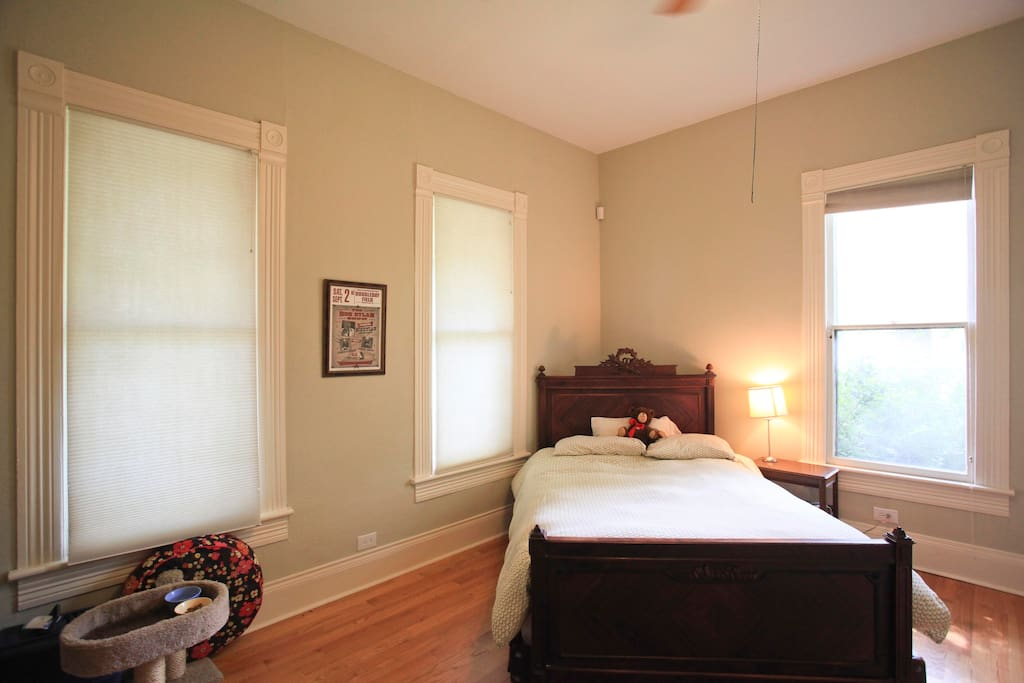 2nd Bedroom with queen bed, with view of side yard and front yard