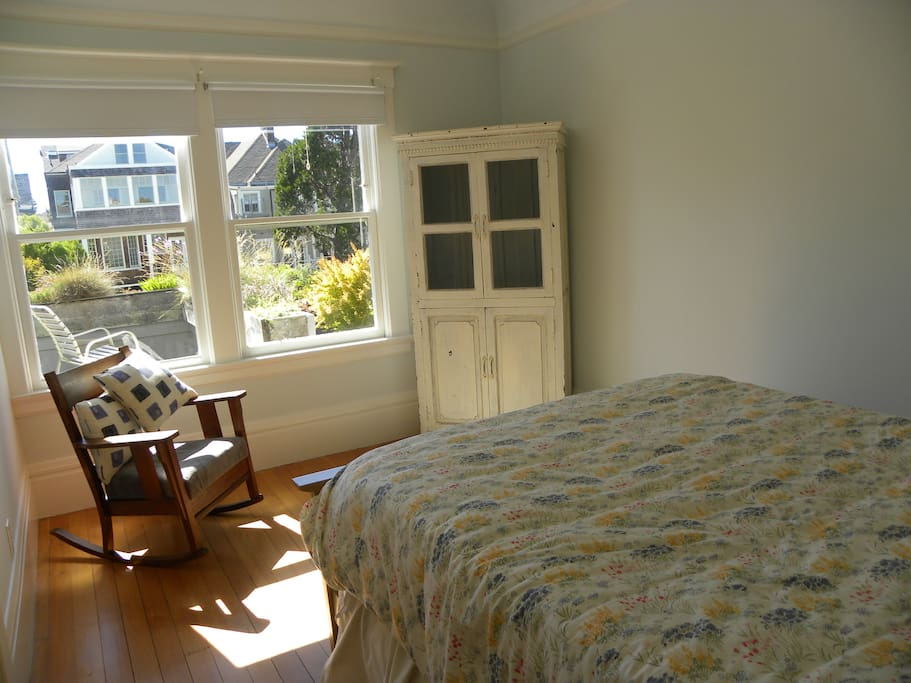Guest bedroom looking out on flowers and trees