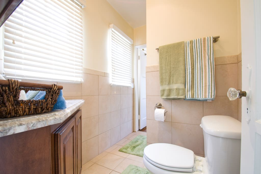 Your own private pass through bathroom (only you will be passing through it), with fresh towels and sunlight.