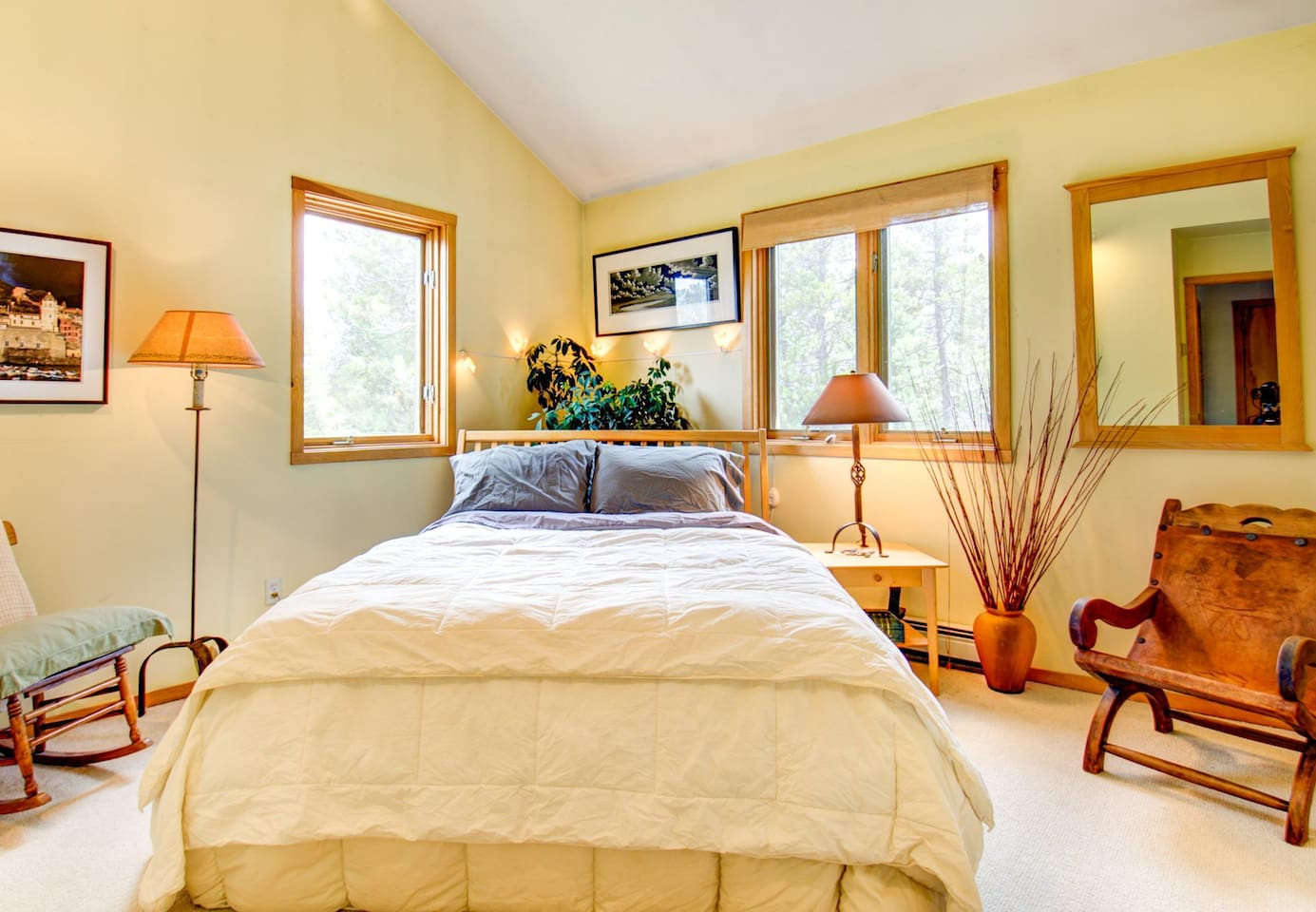This is your guest suite.  Queen size bed, beautiful linens, artwork and a lovely view of the forest.