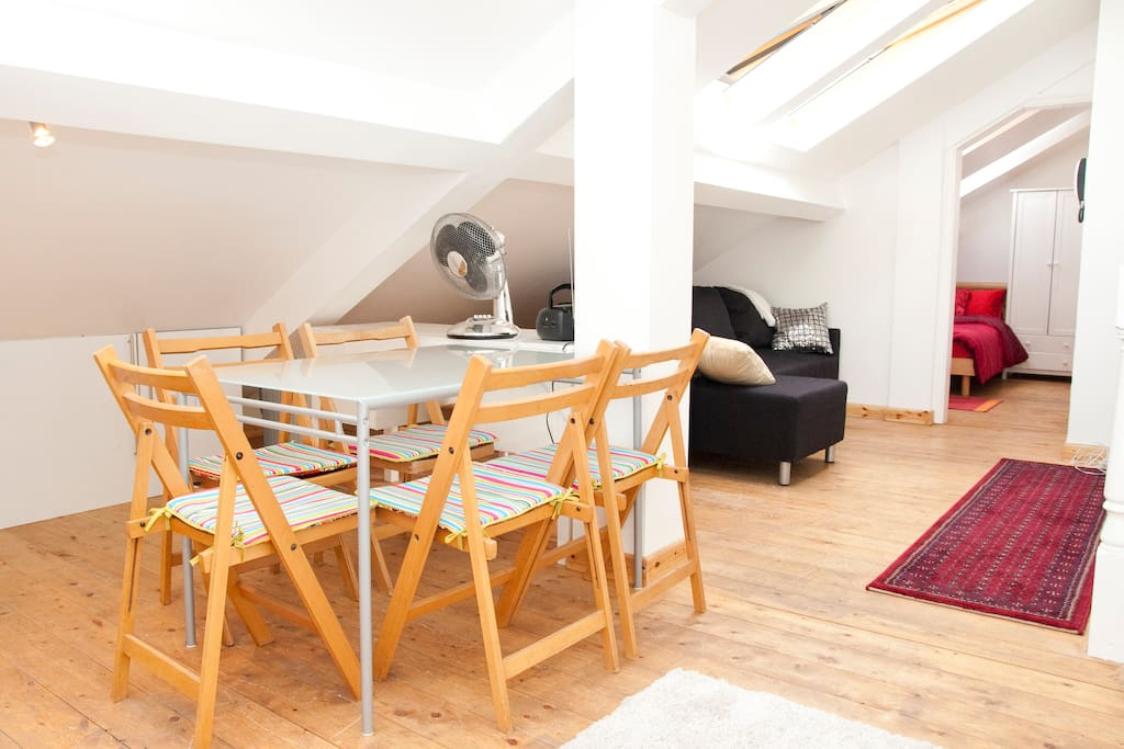 Dining area with view of other parts of the flat