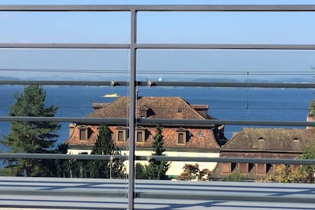 modern room with lake view in Zug