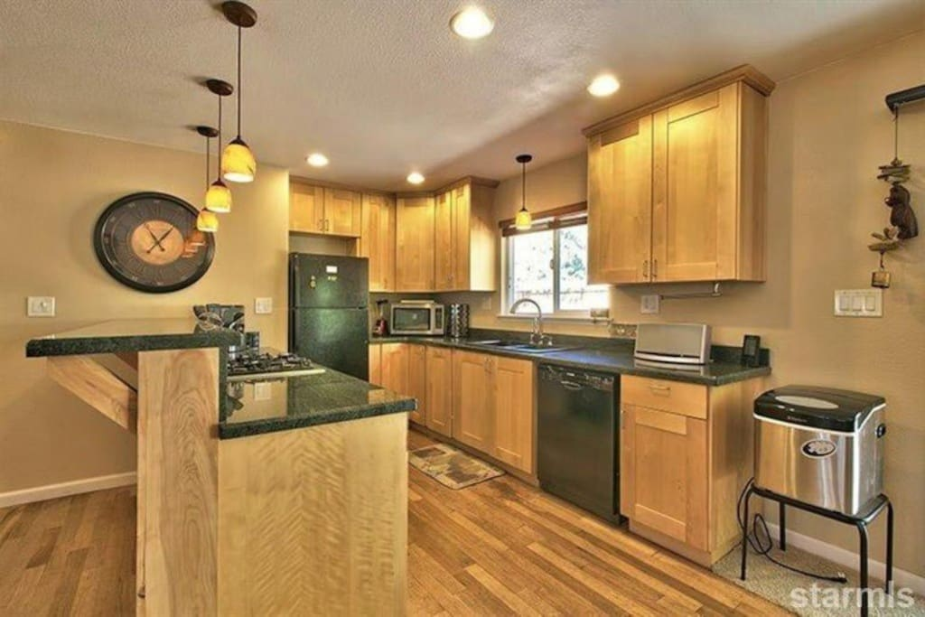 Granite kitchen counter and high end appliances.