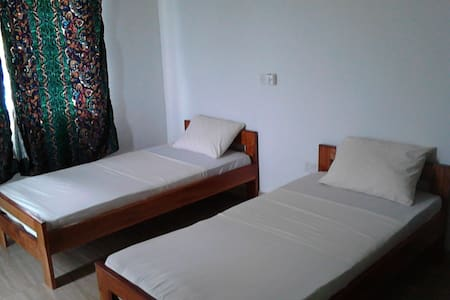 Shared room with two single beds - Kokrobite
