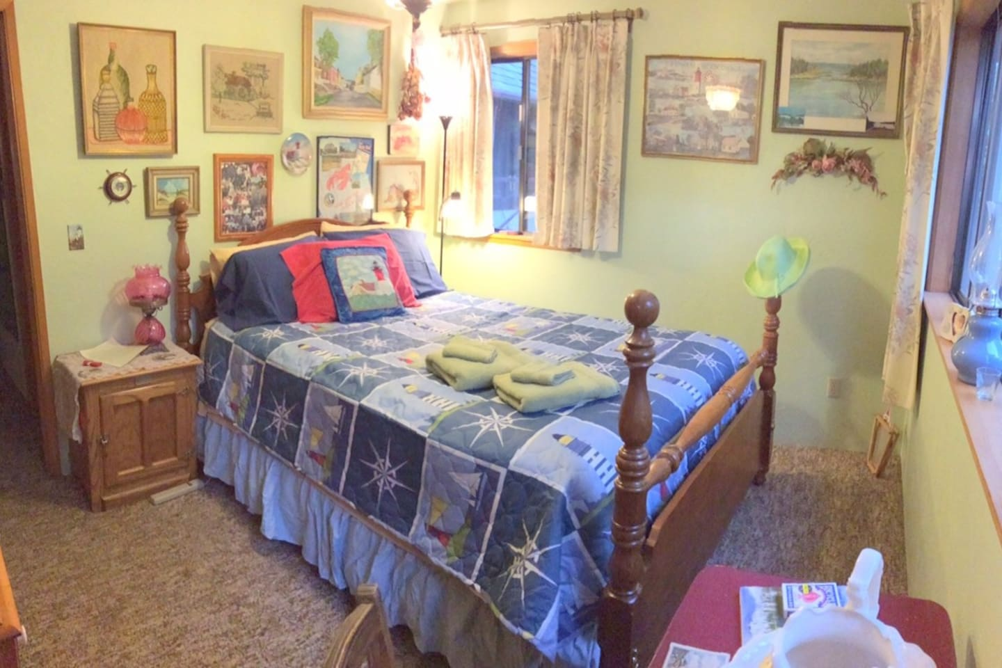 The quaint Cape Cod Room has a queen bed with a private entrance and adjacent full bath with a sauna that is shared