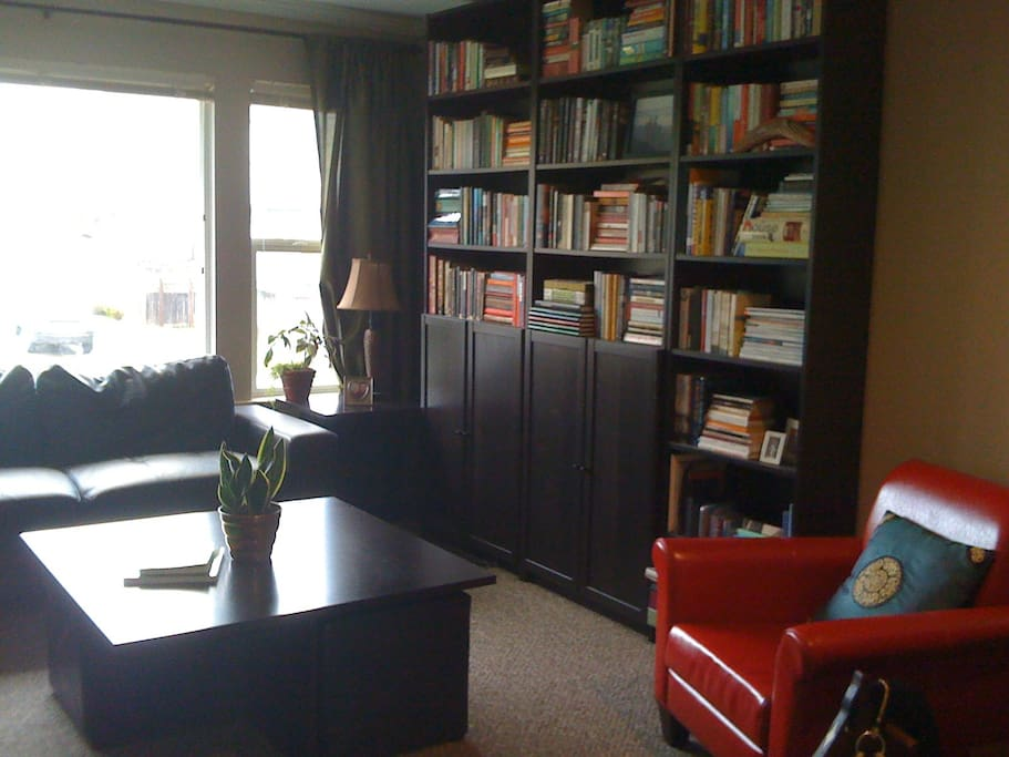 Our library, feel free to curl up in the red chair by the fireplace with a book!