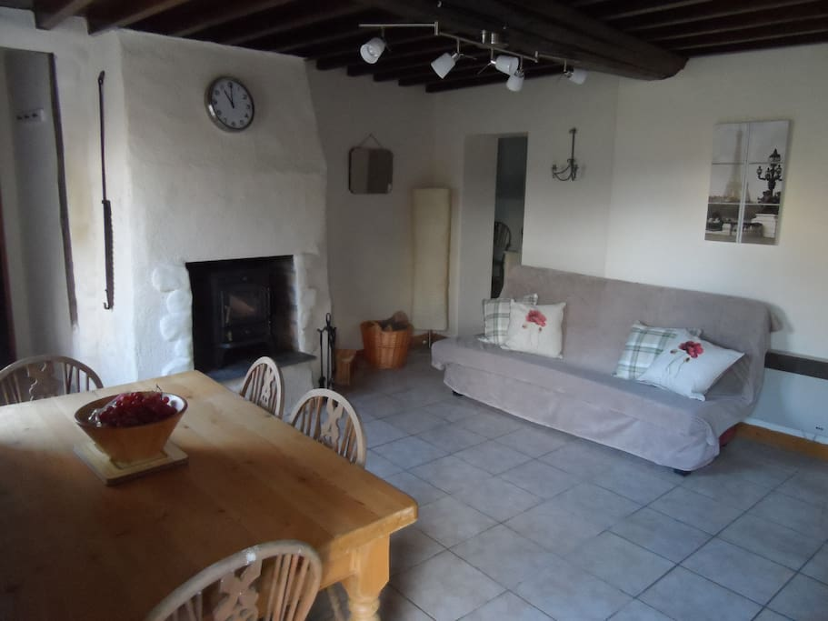 Main living area with fully equipped Kitchen and log burner