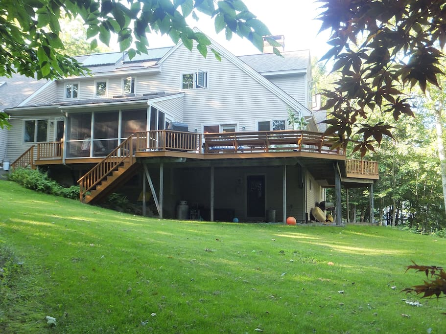 You will love lounging on the wrap-around back deck and screened porch.