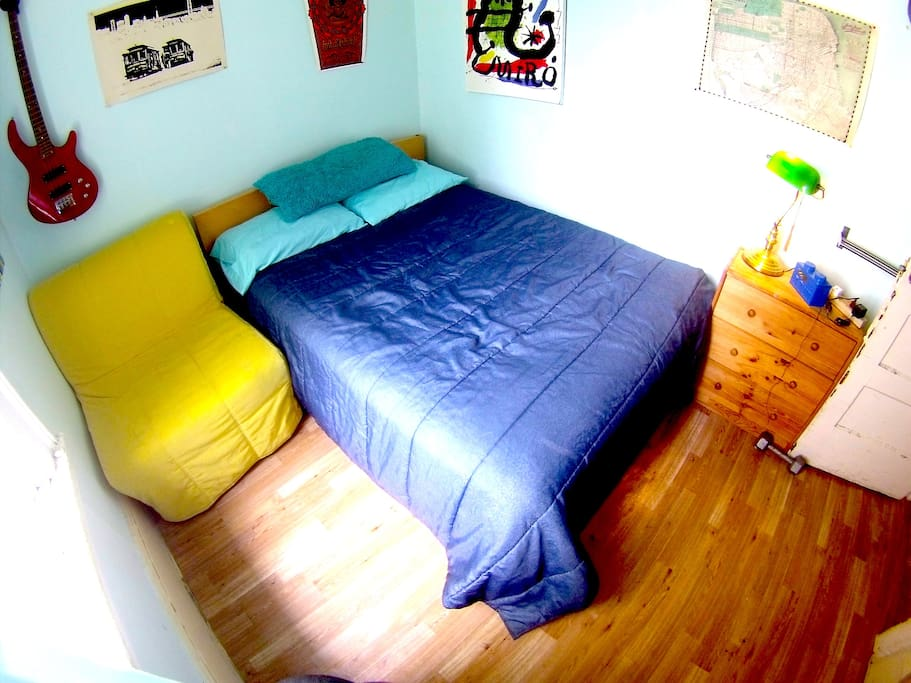Bed, yellow chair turns into a small bed