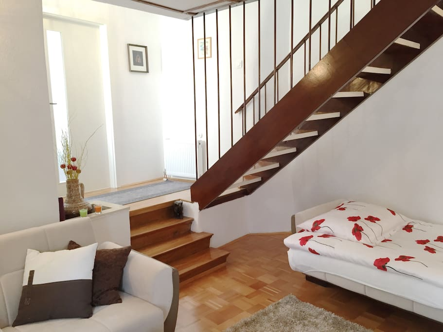 Living Room with stairs to the bedroom in the 1st floor