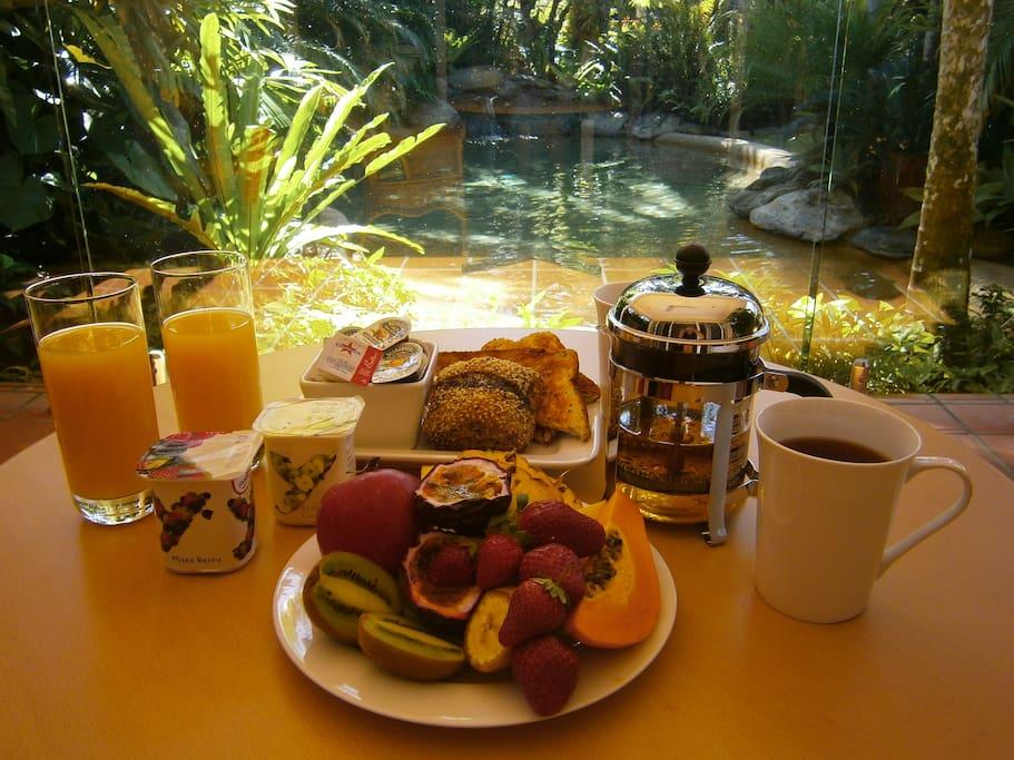 Breakfast is included - al fresco by the pool.