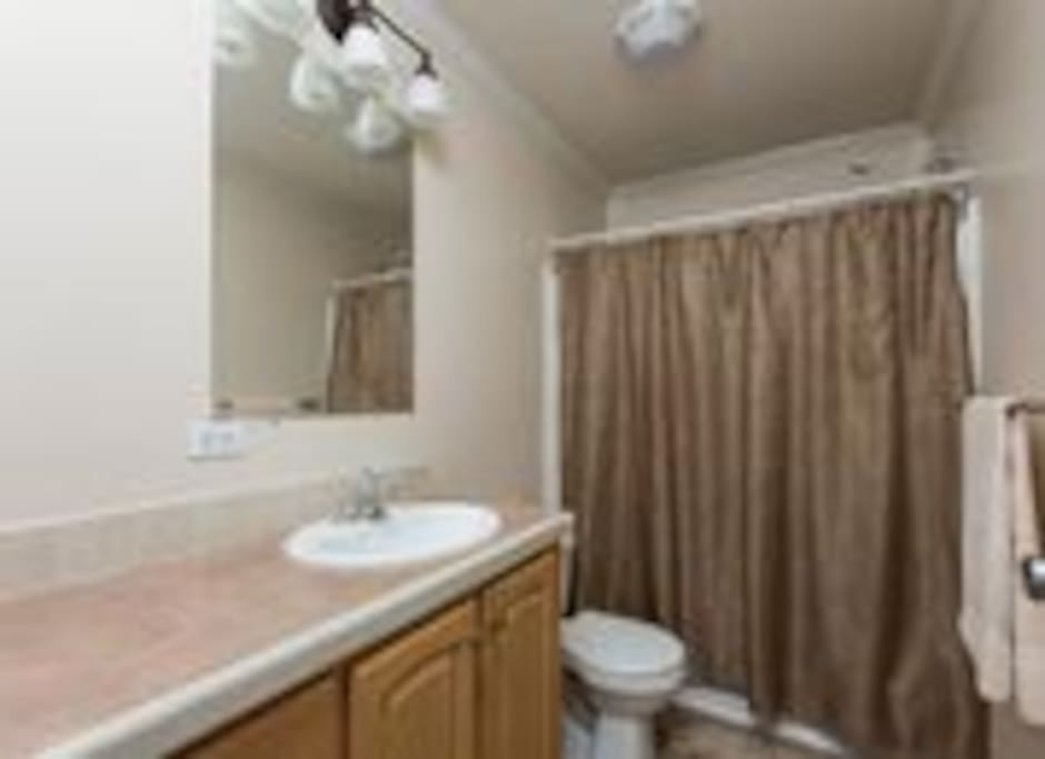 Your private bath directly across the hall from your bedroom.
