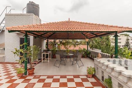 Bright, vibrant room, huge terrace