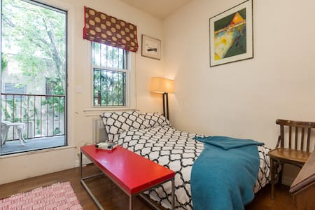 You have your own private bedroom & bathroom on the 1st floor of a townhouse with access to a porch & garden and a big window and wood floors and white walls. Sunny, quiet, recently renovated, clean. 6 minute walk to subway. Peaceful, tidy. Luminous.