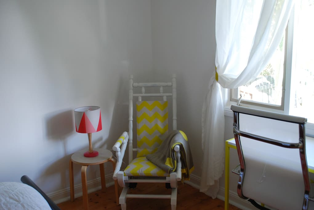 A quirky little rocking chair and lamp create a lovely reading/relaxing n nook