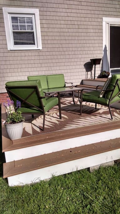 Lounge with the freshly cut grass and flower garden...