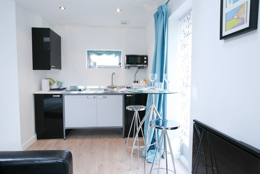 Compact kitchenette with fridge and welcome / breakfast basket included.