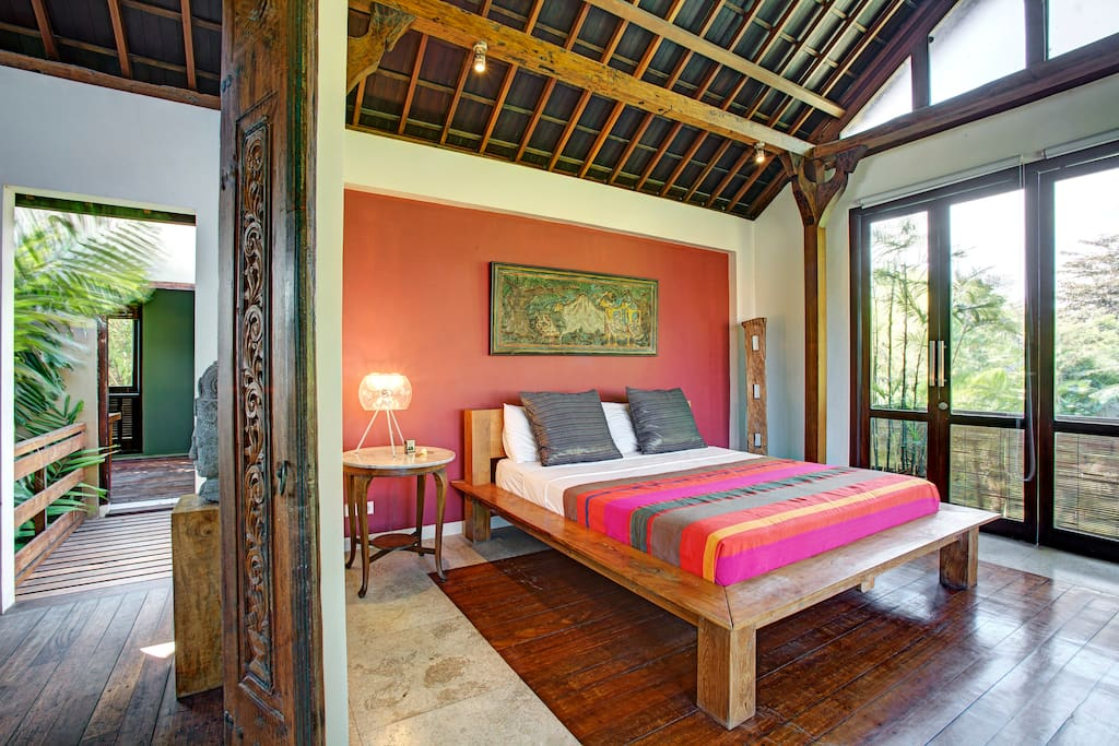 The master bedroom is located on the second floor and features architectural beams from a Javanese traditional wooden house.
