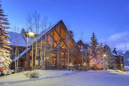 Bear Creek Lodge at Mountain Village is a beautiful option for your family or group getaway. The 31 condos, ranging from one to four bedrooms, each include a gas fireplace and fully updated kitchen with granite countertops and stainless steel appliances. The property is perfectly located adjacent to the Telluride Ski Resort with access via the Lower Village Bypass and a semi-private lift. Free wireless internet, a fitness center, indoor and outdoor hot tubs, a heated pool, and a sauna are all included as amenities at these luxurious accommodations.  Bear Creek Lodge also includes on-site staff and a full service concierge. There is also complimentary parking and a firepit and barbeque patio to enjoy in all seasons.  Business Licence #014927 Perfect property for a stay with the family or as a large group in Mountain Village!   Bedding: king bed, king bed that can be split into 2 twins, king bed, king bed that can be split into 2 twins and queen sleeper sofa.    Enter this condo on the 4th floor and walk into the open dining area and living room with a gas fireplace, flat screen TV and balcony facing the mountainside (forest view). The living room is open to the kitchen with granite countertops and a breakfast bar with seating.     On the main level is a bedroom with a king bed, TV and an ensuite bathroom with jetted tub and separate shower. The 2nd bedroom on the main level has a king bed that can be split into 2 twins, TV and a bathroom in the hallway with shower/tub combo. Upstairs is the master bedroom with a king bed and queen sleeper sofa, TV, walk-in closet and ensuite bathroom with double sinks, jetted tub and separate shower. There is also a safe in the master bedroom. On this floor is another bedroom with king bed that can be split into 2 twins, TV, walk-in closet and ensuite bath with jetted tub and separate shower.    Bear Creek Lodge offers free wireless Internet access, free outdoor parking, fitness center, indoor and outdoor hot tubs, outdoor heated poo