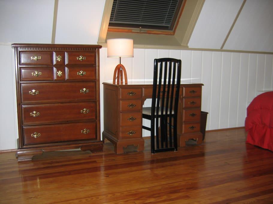 Dresser and desk under a large skylight
